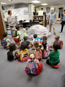 The preschoolers learn about the Earth and the moon.